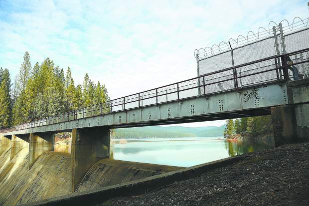 The Scotts Flat Dam and spillway as shown from the Cascade Shores side where a fence with razor wire has been erected. NID is considering adding more fence and razor wire to completely surround each side of the spillway's pathway to prevent people from climbing around the gate when the path is closed.