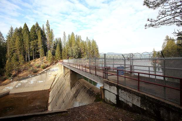 The Scotts Flat Dam and spillway as shown from the Cascade Shores side where a fence with razor wire has been erected.