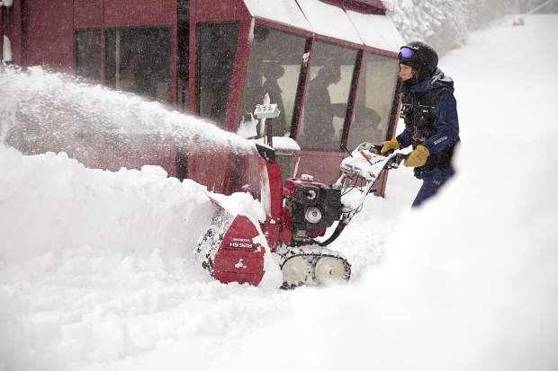 A Northstar California employee works to remove snowfall after last weekend's storm.