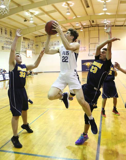 Forest Lake Christian's J.R. Molloy flies to the basket during fourth quarter game play during Wednesday's win over Freedom Christian.