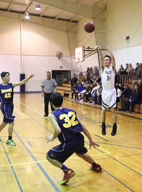 Forest Lake Christian's Aidan Miller (14) fires off a shot from behind the 3-point arc during Wednesday's game.