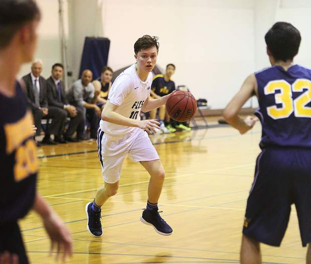 Forest Lake Christian Luke Gilliland brings the ball up the court for the Falcons during Wednesday's playoff win. Gilliland finished with a game-high 29 points, including eight made 3-pointers.