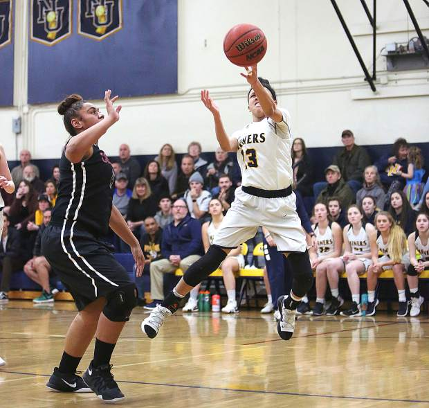 Nevada Union sophomore Aijah King (13) attacks the basket for two of her 13 points during a first round playoff win Tuesday. King also grabbed seven rebounds and doled out four assists.