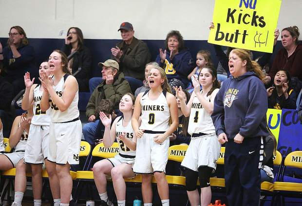 The Nevada Union Lady Miners sideline and fans erupt after their team makes a play on the court during Tuesday night's 62-47 win over the Cordova Lady Lancers.