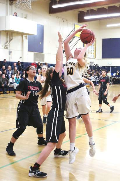 Nevada Union junior Emerson Dunbar (20) goes up for a shot during Tuesday's playoff win over visiting Cordova. Dunbar scored 12 points, and came away with 10 rebounds in the win.