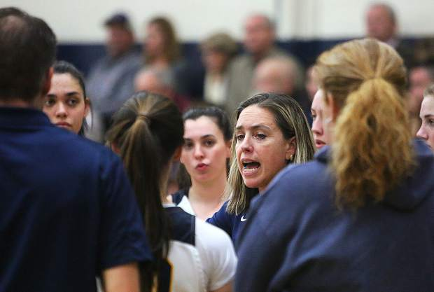 Nevada Union Lady Miners head coach Jenn Krill gives some pointers to the team during a timeout on the sideline of Tuesday's first round playoff win over the Cordova Lady Lancers.