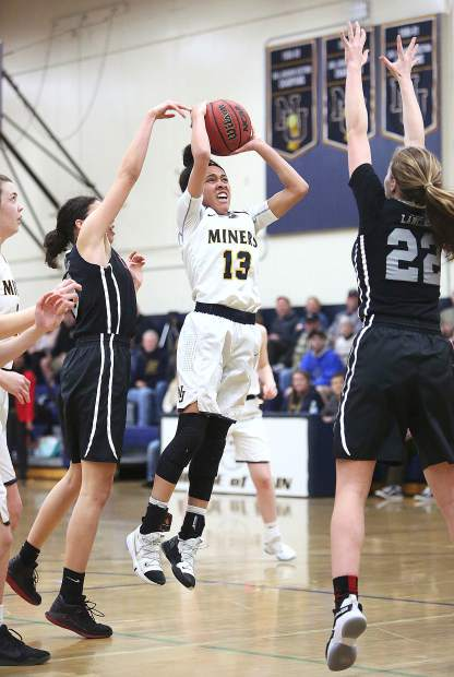 Nevada Union sophomore Aijah King (13) attacks the basket in the face of the Lady Lancer defense during Tuesday's first round playoff win. King scored 13 points, grabbed seven rebounds and doled out four assists.