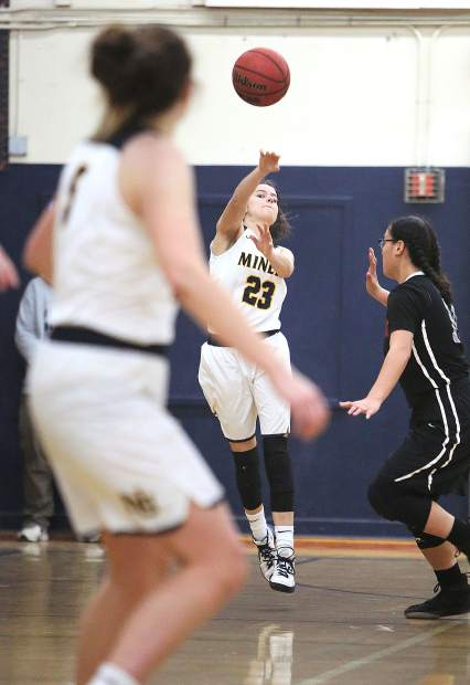 Nevada Union's Leah Ellis (23) makes a strong pass down the court to an open teammate.