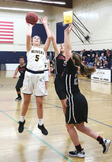 Nevada Union's Meadow Aragon (5) puts up two of her 26 points during Tuesday's playoff win over the Cordova Lady Lancers.