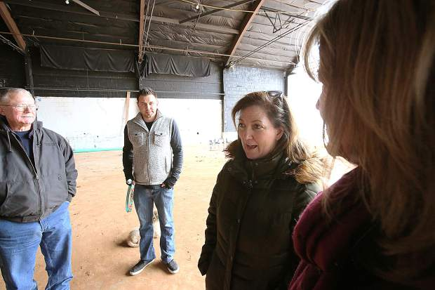 Project superintendent Kevin Jamison (from left), Tru-Line Builders' Daniel Swartzendruber, Center for the Arts' Amber Joe Manuel, and Project Manager Diane McIntyre discuss the project last week during a walk through of the site.
