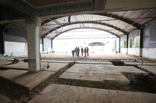 Center For The Arts remodel project personnel take a walk-through tour of the center's progress last week. Guides showed the frame of the former car dealership above as well as the foundation work being done for the tech mezzanine below.