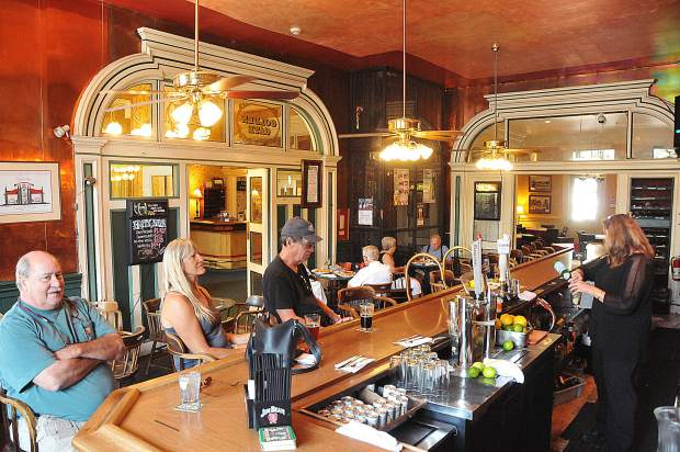 Patrons sit in the historic Golden Gate Saloon, one of the oldest continuously operating saloons on the west coast.