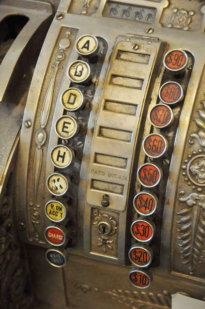 An old cash register sits in the entry way of the Holbrooke Hotel.