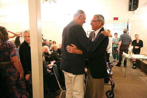 Nevada County community members embrace one another during Friday's