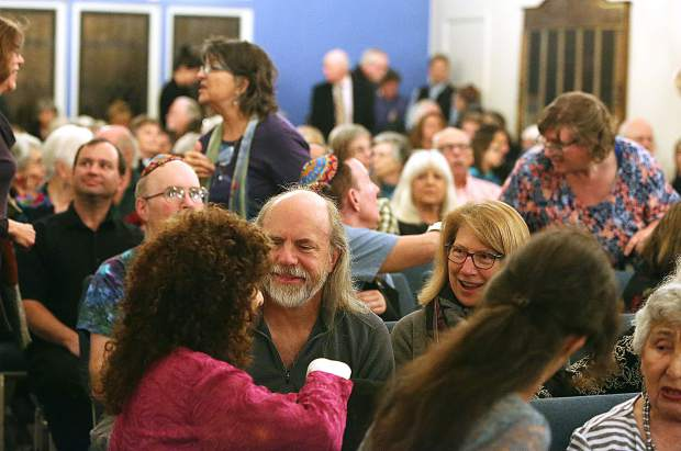 The Nevada County Jewish Community Center was packed with people. Extra chairs had to be brought in for the standing room only crowd.