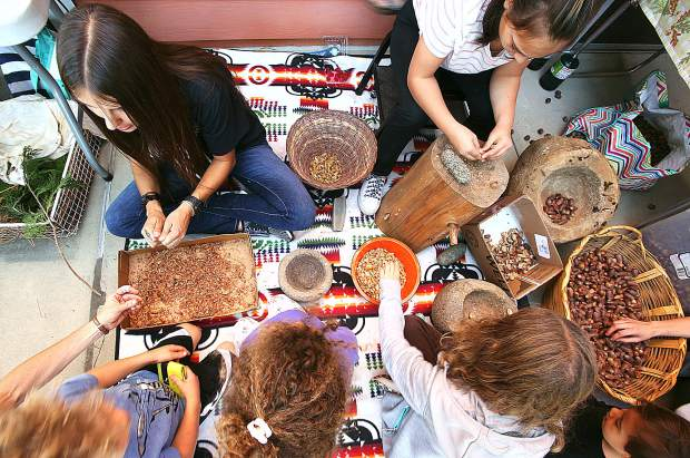Local youth are shown the process of making acorn soup and bread during Saturday's Nisenan Heritage Day at Sierra College.