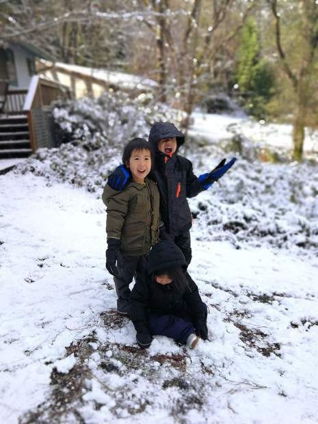 Calliope, Dillinger and Frida Natividad enjoyed the snow Thursday, playing on their Alta Sierra home driveway. Law enforcement closed down the entrance to Alta Sierra Drive in Grass Valley momentarily due to snowfall.