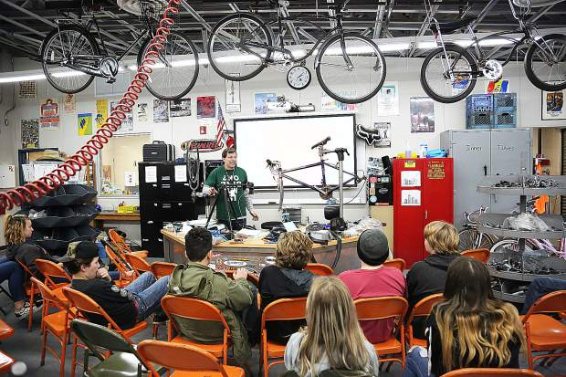 Bicycle Recycle Project instructor Steve Gillespie (center) instructs his students at the Seven Hills Middle School bike shop Wednesday.