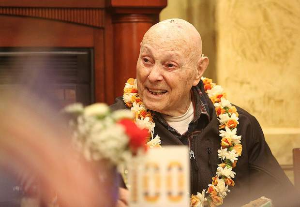 Figara smiles as he listens some of the fond and funny stories that members of his family and friends told to those in attendance of his 100th birthday celebration at Kane's Restaurant.