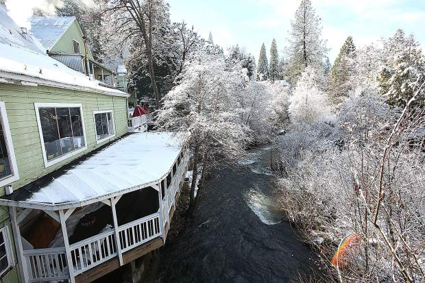 The waters of Deer Creek have receded adjacent Leftys Grill in Nevada City, now covered in snow Thursday morning.