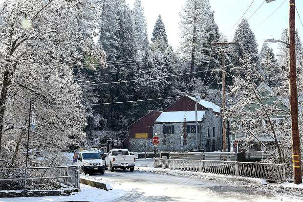 A snow covered Stone House is nestled among the trees of Nevada City Thursday morning.