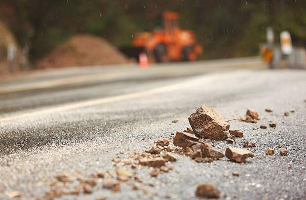 Sharp rocks from a fresh mud and rock slide sit alongside Highway 49 north of Newtown Road Tuesday morning.