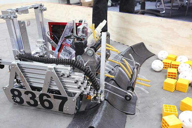 The design of ACME Robotics' 18 x 18 inch robot efficiently scoops up wiffle balls and blocks before sorting them accordingly. A task for the robot is predetermined for competing schools to engineer during the world championships in Houston.