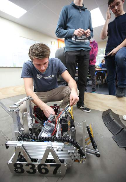 Nevada Union High School's Shawn Rashby makes some adjustments to the ACME Robotics team's robot during a demonstration Thursday.