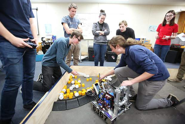 ACME Robotics team members at Nevada Union High School make adjustments to their robot Thursday. The group is making their final adjustments to their robot for competition next month in Houston Texas.