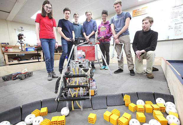 Nevada Union High School's ACME Robotics team members Emma Sheffo (from left), Aidan Reedy-Schneider, Ashlan Arriaga, Kelly Muir, Shawn Rashby, Oren Stallings and Jon Whitcomb demonstrate their nearly ready robot that they will be using to compete against other school robotics teams during the world championships in Houston Texas.
