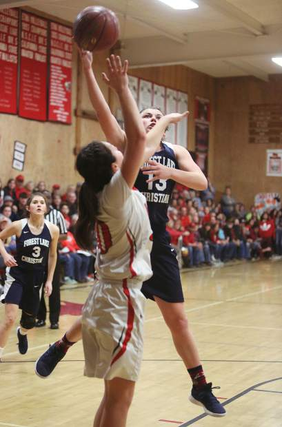 Ali McDaniel takes it to the hoop and attacks the basket in the face of an Etna defender during Tuesday's loss to the Lions.