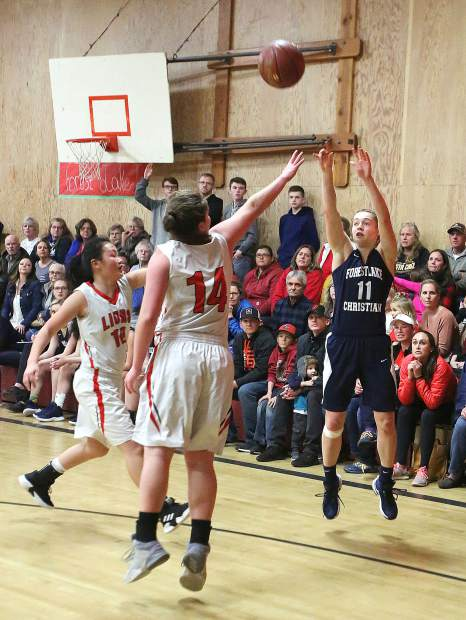 Forest Lake Christian junior Amber Jackson (11) takes a shot from beyond the three point line during Tuesday's game in Siskiyou County.