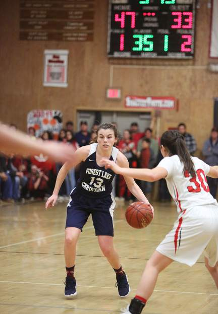 Forest Lake Christian junior Ali McDaniel (13) brings the ball up the court for the Falcons during Tuesday evening's Nor Cal D VI championship game against the Etna Lions.