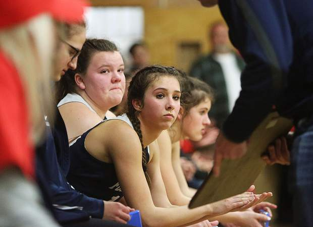 Forest Lake Christian seniors Breezy Adams and Lily Sween glance at the second place Nor Cal D VI trophy that they received after their 72-51 loss to the Etna Lions Tuesday night in Siskiyou County.