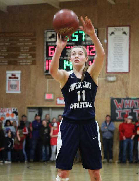 Forest Lake Christian junior Amber Jackson (11) heads to the free throw line during second half game play against the Lions.
