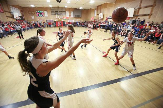 Bella O'Neil (12) throws the ball inbounds in a packed Etna High School gymnasium where Forest Lake Christian took on the Etna Lions in Siskiyou County for the Nor Cal D VI championship game.