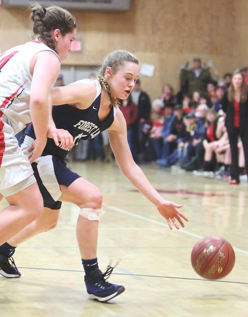 Forest Lake Christian junior Amber Jackson (11) pushes past an Etna defender during Tuesday's game in Siskiyou County.