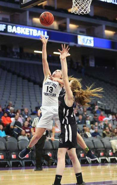 Forest Lake Christian junior Ali McDaniel (13) puts up a layup during Friday's championship game against Valley Christian Academy Friday at the Golden 1 Center in Sacramento.