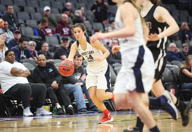 Forest Lake Christian's Lily Sween (14) drives the ball up the court for the Lady Falcons during Friday's championship game.