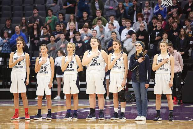 Members of the Forest Lake Christian Lady Falcons stand for the pledge of allegiance prior to Friday's championship game.