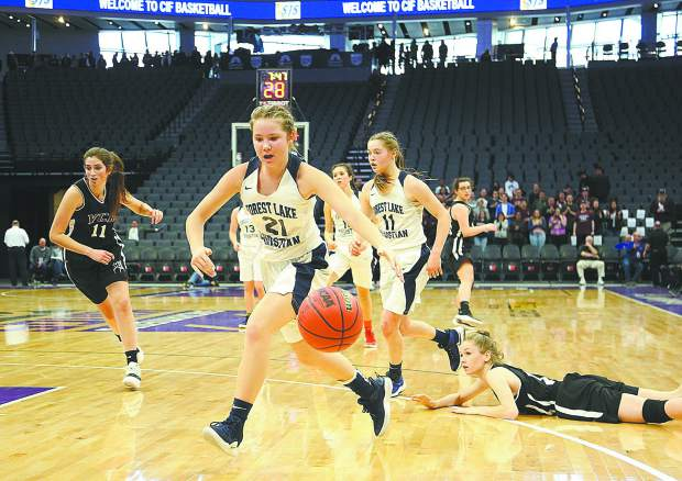 Ellie Wood (21) drives the ball to the basket for the Lady Falcons during Friday's championship game against Valley Christian Academy.