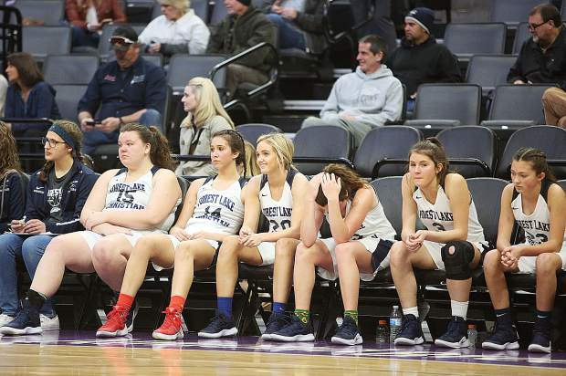 The Forest Lake Christian varsity Falcons react on the bench after losing the D VI championship game to Valley Christian 56-50.