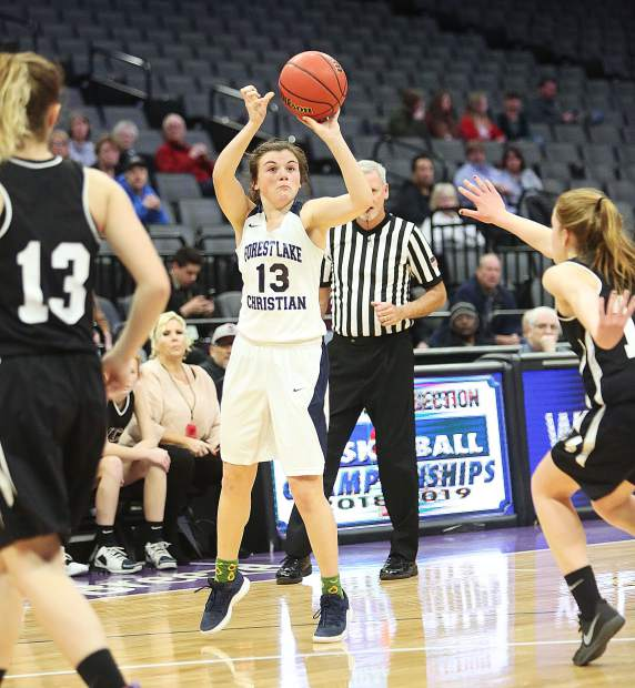 Forest Lake Christian junior Ali McDaniel (13) takes a jump shot during Friday's championship game against Valley Christian Academy Friday at the Golden 1 Center in Sacramento.