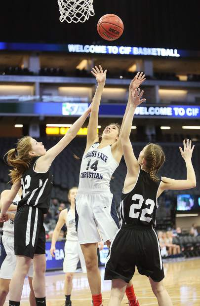 Forest Lake Christian's Lily Sween (14) attacks the basket during second half game play against Valley Christian of Roseville for the D VI championship at the Golden 1 Center in Sacramento Friday.