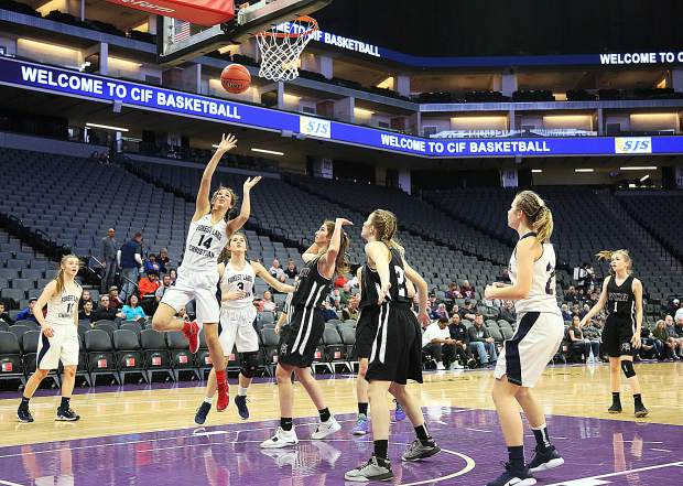 Forest Lake Christian's Lily Sween (14) attacks the basket during second half game play against Valley Christian of Roseville for the D VI championship at the Golden One Center in Sacramento Friday.