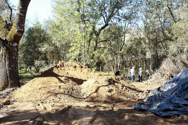 Piles of dirt are brought on site to be used to build the dirt bicycle paths through the oak woodlands of Western Gateway Park in Penn Valley near the dog park.
