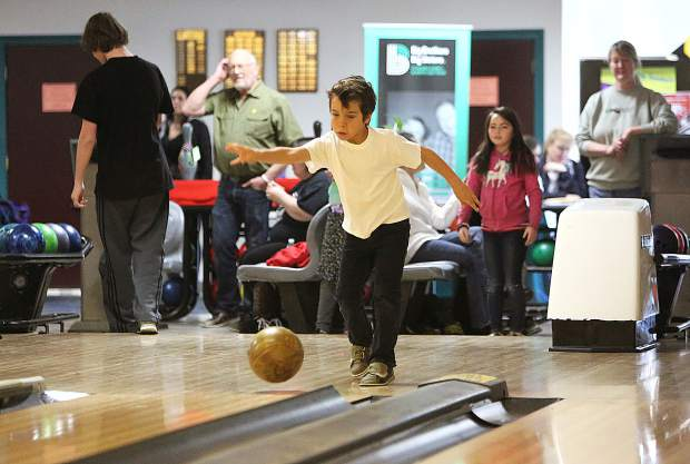 Six-year-old Alex Villani from the Big Brothers Big Sisters program lets one go during Saturday's fundraising event.