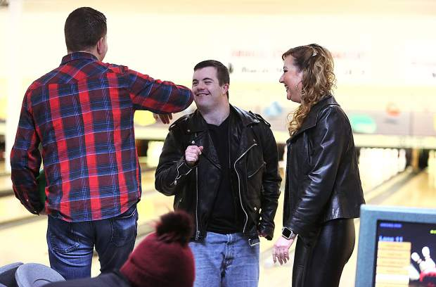Skyler Tonti gets a high fives from his fellow team mates during the 37th annual Bowl For Kids Sake at Prosperity Lanes Saturday.