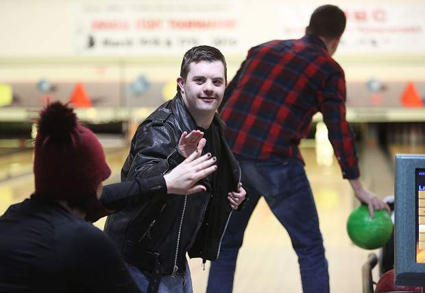 Grass Valley resident Skyler Tonti gets a high five from his teammates during the 37th annual Bowl For Kids Sake at Prosperity Lanes Saturday.