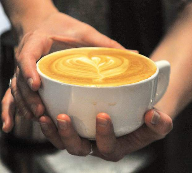 A warm latte is made by Natalee Heilaman Thursday at Brew Bakers in Grass Valley.